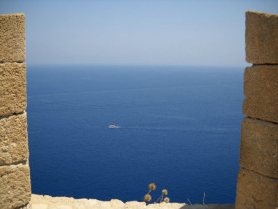 my photo looking down on the mediterranean from the acropolis of lindos. this was part of the castle walls built by the knights of st. john during the crusades