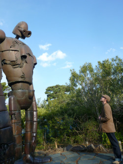 archiemcphee:  Remember our recent post about the awesome sculpture of Miyazaki's robot soldier from Laputa: Castle in the Sky that lives at the Ghibli Museum in Tokyo? Remember how much we all wanted to go see it? Well here's talkingbreakfast visiting that very same robot! This photo gives you a great sense of just how tall the robot is.  We wish we could have gone with you! Thanks for the submission!     I dream about this! If anyone would take me, I will give you anything! (my life if you really want it)