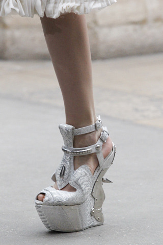 McQueen. I'm loving the ridiculous trend for ever-more-dangerous shoes. *golf claps*