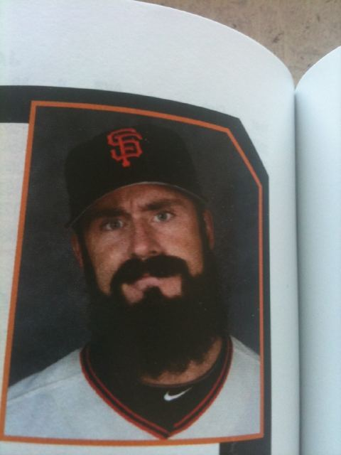 Brian Wilson's photo in the Giants 2011 media guide. (Image via @extrabaggs)