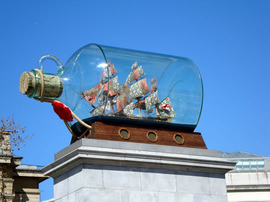"Yinka Shonibare, ""Nelson's Ship in a Bottle"" (2010)  The Fourth Plinth in London's Trafalgar Square is a great example of turning a failure into an opportunity. The other 3 plinths in the majestic square in the city center feature statues of historical figures, but the fourth was never built due to lack of funding. It lay empty for over 150 years until the Royal Society of the Arts came up with the fourth plinth project, commissioning art works for temporary installation. The Greater London Authority now runs the project. Shonibare's proposal was chosen for 2010, and is the first to feature an object directly engaged with the square's namesake, the British naval victory during the Napoleonic Wars. The ship in the bottle is Admiral Lord Nelson's HMS Victory, hung instead with batik cloth sails.  Shonibare spoke of the piece's contemporary cultural significance to the Times: ""It's very much a contemporary phenomenon that we take what we want from different cultures,"" he says. ""We might eat Indian today or hang out in Spain tomorrow. I celebrate that, it's not unique to me just because of my African origins. It's the way that most British people live their lives now. In a sense that's what this piece is celebrating, it's the legacy of Nelson. Nelson fought this battle against Napoleon and that meant that for the next 100 years or so the British had control of the seas. Which meant that the Empire could prosper and expand, and that process really did take in other cultures. One consequence of that is the very multicultural city that we have today."""