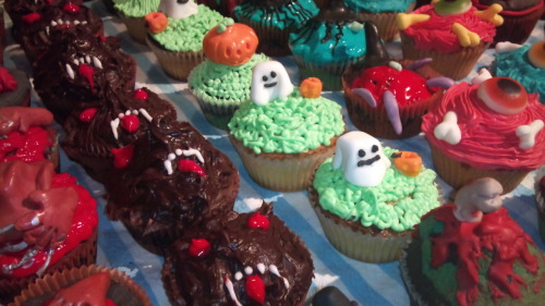Werewolf, ghosts, eyeballs and pumpkin cupcakes made by my fiancee last Halloween.  I made the Alien chest buster one in the bottom right.