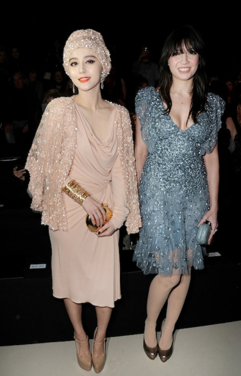 mariankihogo:  Delicious Sequin Overload. Fan Bing and Daisy Lowe at Elie Saab Fall Winter 2011.  Are they tight friends or something?!?!