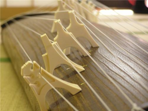 Scales of the Dragon. The shape of the Japanese Koto, a thirteen-stringed string instrument, is modeled after the Asian dragon. - Michelle Danner
