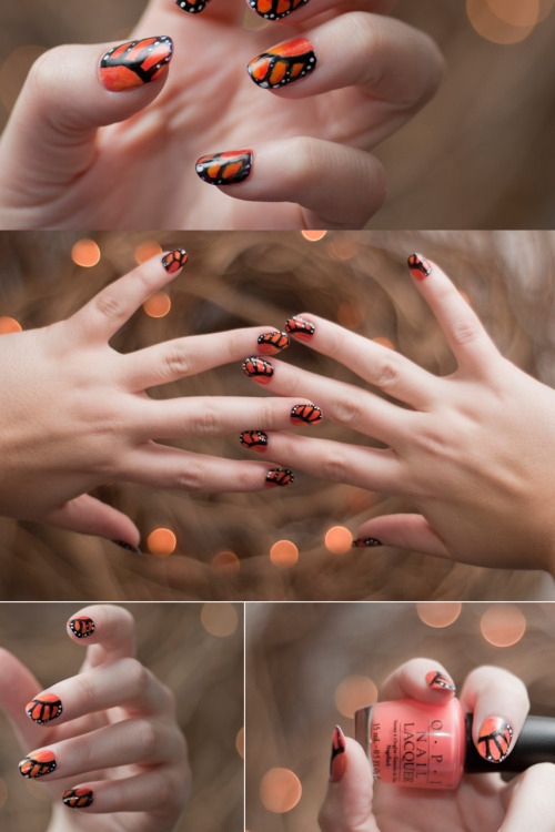 Monarch butterfly wing style manicure.  Yes I painted these all by hand!   Colors Used:  Too many to list, but several OPI and Pure Ice colors were involved. Hand painted with a tiny brush & dotting tool.  Photo taken by C. Wade