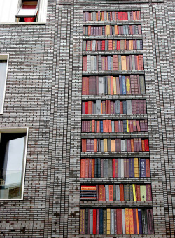 bookoasis: Building in Amsterdam West, designed with ceramic books (by andrevanb)