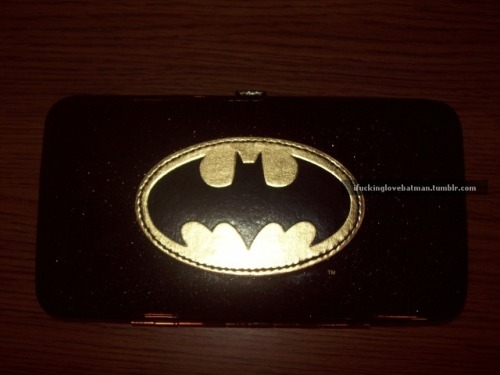 Standard hinge wallet, now in Batman! $12 at Wal-Mart, in-store only. These are not cheaply made at all, they're just as durable as any hinge style wallet out there. ID slot with 4 other card slots (you can fit 2 cards in each slot without it getting too cramped), zippered change compartment, and two pockets for cash, checks, coupons, etc. Emblem is metallic gold and the black is flecked with micro gold and silver glitter. The photos don't do this justice, these look so much better in person!  Follow this girl; she is awesome! Love her submission! HEART EYES.