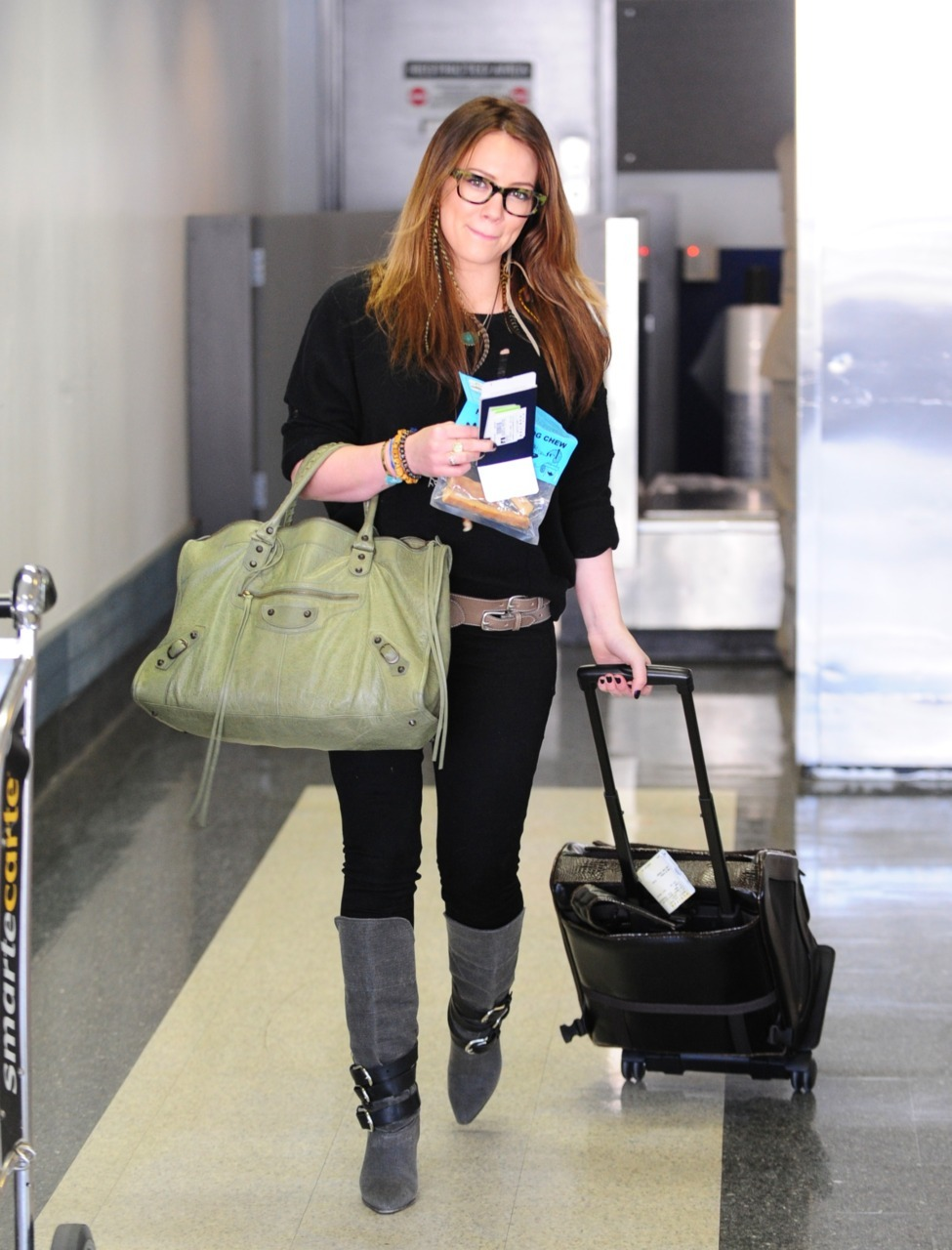 Hilary Duff flying out of LAX Airport - March 10, 2011