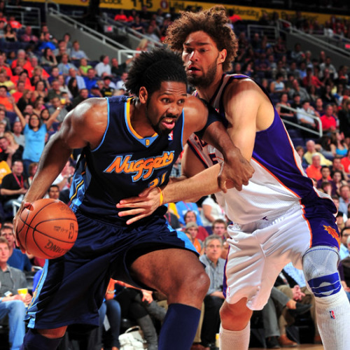 Nene drives through Robin Lopez's lack of defense. The Nuggets beat the Phoenix Suns 116-97 tonight! Nene was the leading scorer with 22 points! The Nuggets looked unstoppable, even without Gallinari and Afflalo (who are expected to play again Monday vs New Orleans Hornets). The Nuggets improve their record to 38-27, which keeps them in 5th position in the Western Conference. The Nuggets play the Detroit Pistons on Saturday 7:00 pm MT.  Photo by: P.A. Molumby/NBAE via Getty Images