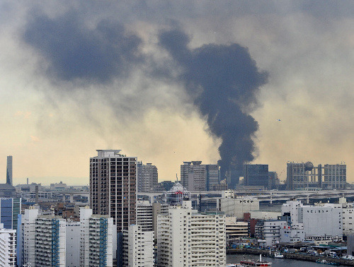 clinging:  buildings burning with black smoke. Chuo Ward, Tokyo.
