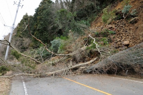 A large landslide closes a major road near Iwaki City in Japan. The landslide was triggered by a massive 8.9-magnitude earthquake that struck Friday afternoon. (Reuters)