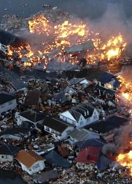 Houses burn after being swept out to sea following a tsunami triggered by a magnitude-8.9 earthquake in northern Japan. (Reuters)
