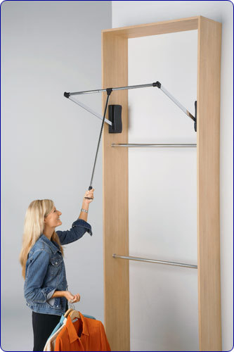 Hard-to-reach areas are a closet's no-man's-land. A spring-loaded pull-down rack, which you can install yourself, solves the problem. A light tug on a handle positioned in the center of the rod brings clothes to you.  Courtesy of Martha.  Shop here