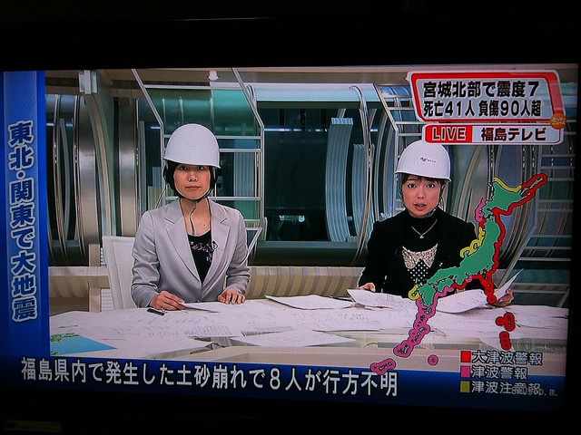 pepediokno:  Japanese broadcasters on air during the earthquake, anchoring live, with helmets on.   inothernews:shortformblog:rubenfeld:ryanhatesthis:jhermann:ericmortensen:by Dave Weekes         Dedication.   Japan, I love you.   News.   Reblogging for reasons other than humor value.   Earlier this morning (EST), we saw journalists staying at their desks, typing away and taking phone calls while the world was essentially shaking around them.  These anchors were inside studios, sitting beneath heavy, white-hot lighting grids, seemingly (but not) oblivious to the dangers they faced trying to get the word out about the disaster wracking their country and killing their fellow citizens.  Elsewhere in the country were photographers, reporters, producers, camera operators, helicopter pilots — all gathering the news.  This is supreme dedication to their profession; we are thankful and humbled by their steadfastness in the face of tragedy.