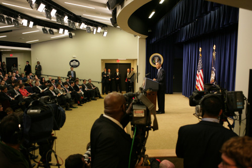 "PHOTO OF THE DAY: President Obama gives a press conference at the White House on  Friday. Obama urged leaders in the Middle East to seize the ""great  opportunity"" presented by the current turmoil to conduct much-needed  political and economic reforms. He also addressed the earthquake that  struck Japan. (CHRIS KLEPONIS/AFP/Getty Images)"