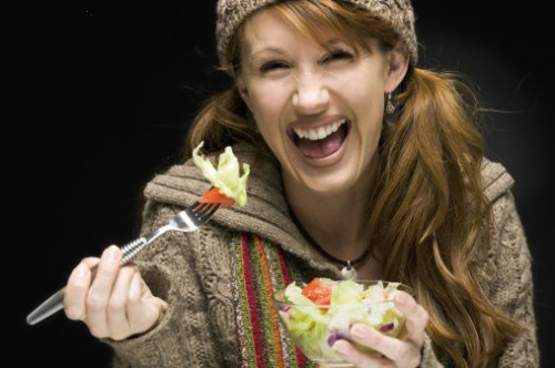 Women laughing alone with salad Gallery of similar stock photos. via the hairpin