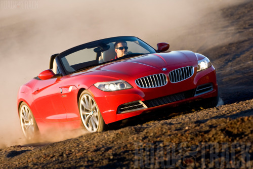 Playing in the dirt with the exhilarating 300-bhp twin-turbo BMW Z4 sDrive35i.It revs to its 7000-rpm redline with a glassy-smooth snarl when you put your foot in it, yet the extremely wide torque band (300 lb.-ft. of torque from 1400-5000 rpm) also allows you to trundle in relaxed fashion — or rocket out of the corners at will.