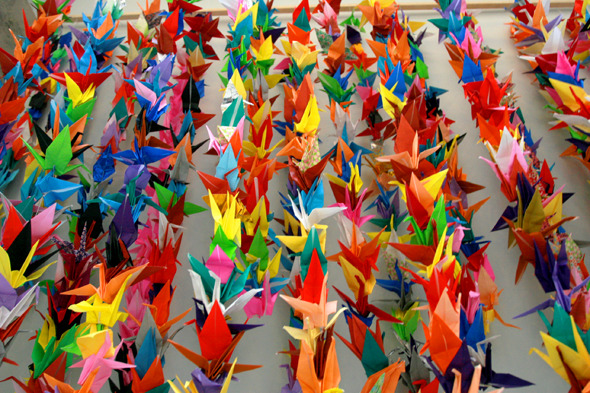 insightfullens:  Paper Cranes for Japan. Cranes are sacred creatures in Japanese culture. According to ancient legend, anyone who folds a thousand origami cranes will be granted a wish—like long life or recovery from illness—by a crane. DoSomething.org aims to collect 100,000 photos of origami cranes from young people to represent 100 wishes for relief and healing to all who are affected by this tragic natural disaster.  http://www.facebook.com/papercranesforjapan?sk=wall