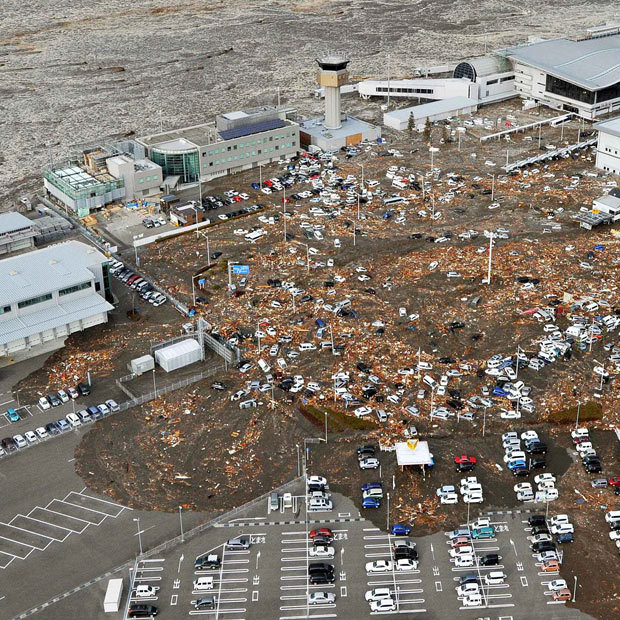 apsies:  Cars and debris are carried by the tsunami at Sendai Airport in Miyagi Prefecture. (AP)