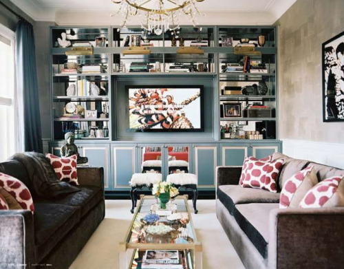 Love the mirrored backs of the bookcases.