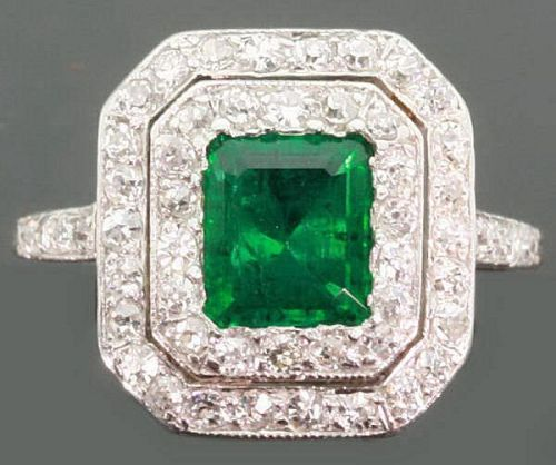 Brazilian emerald and diamonds ring Art Deco  Untempered luxury and exquisite craftsmanship are expressed in this  jewel. Attractive and fashionable ring in pure Art Deco  style of the 1920s featuring a natural Brazilian emerald and 52 old cut  diamonds. Platinum is used freely with great effect in setting gemstones  and achieving light and lively mount, precise shapes and outlines.