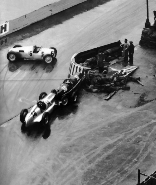 1936 Monaco,  the track was wet because of the torrential rain, On lap 1 Tadini's Alfa was leaking oil, so on the second lap 6 cars(incluiding Tadini) crashed nearly at the same spot.  No one got hurt.   Photo submitted by  http://asaucerfulofwheels.tumblr.com  Thanks =)