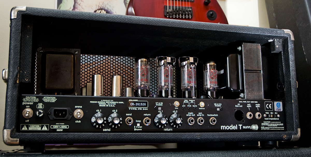 "Sunn Model T 90s reissue with a Mercury-made output transformer intended for the original 70s Model T. It's a huge transformer (on the right in the picture, larger than the amp's power transformer). You can see the old one on the right side in this picture. Some extra volume, LOTS of extra bandwidth. The new OT's 2-ohm secondary tap and ultralinear primary taps are unused in this amp, and there is no lineout winding, so the XLR output is gone. It also has a slightly lower primary impedance, at 2.2k, vs. the old one's 2.35k. The main change is in the character of the sound at really high volumes, where there's quite a bit more clarity. KT66s will no longer fit because the clearance on the OT end is too small. I had all but given up on them anyway for touring applications, because they seemed to stress the heater supply and the bias wasn't stable enough for touring applications. I'll still use 2 of them for recording at half-power, but for touring it's 6L6GCs. Cheaper, cooler-running, more stable, higher headroom. I also recently realized that the presence circuit on these amps is wired to remove upper-mids and treble when rolled down, rather than to add sparkle when turned up. Flat response corresponds to about 9.5 on the control, compared to a lot of amps where the minimum setting is neutral and higher settings add treble. This circuit's corner frequency is 650Hz (really low!) and with the presence below 9, significant extra negative feedback is added above the corner frequency to the inverting input of the phase inverter. This is quite different from the other Fender amps that use this same power amp configuration and stock OT, which typically have no presence control or one with a more center-neutral setting. I think this explains a lot of why this amp has a reputation for being ""dark"" even though it's a very typical Fender circuit. Keeping the presence down will change how much perceptible headroom the amp has too; you'll think it's breaking up (and farting out) a lot earlier on the volume dial. For more info on this circuit, look here."
