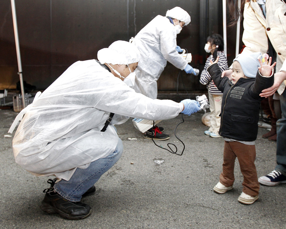 Photos: Japan reels after deadly quakeOfficials in protective gear check for signs of radiation on children who are from the evacuation area near the Fukushima Daini nuclear plant in Koriyama, March 13. (REUTERS/Kim Kyung-Hoon)Graphic: Japan radiation spread a reasonable fear Graphic: Diasaster in Japan — The Wave Graphic: Diasaster in Japan — The Quake
