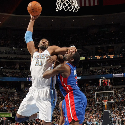 In your face! Nene scored 18-points in Nuggets 131-101 win over the Detroit Pistons. JR Smith scored 9 three pointers, 31 points in total! This was a fun and entertaining game by all the Nuggets' players. Can't wait 'till their next game vs New Orleans Hornets on Monday at 6 pm! Photo by: Doug Pensinger/NBAE/Getty Images