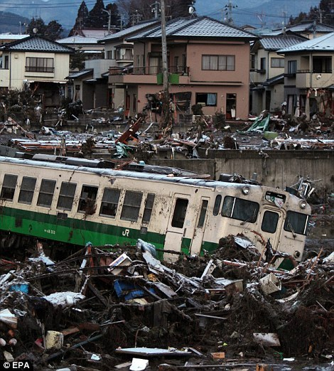 do-nothing:  Japan earthquake pictures: Devastation as rescue workers fight fires and search for survivors | Mail Online