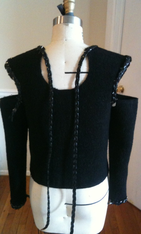 black boucle shirt. working on the patent leather braided trim.
