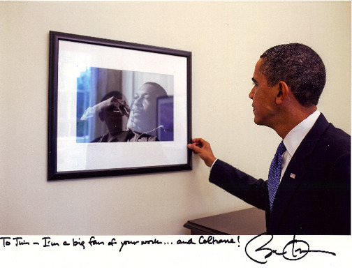 President Obama admires a Jim Marshall photo of John Coltrane. Via Jim Marshall LLC Blog