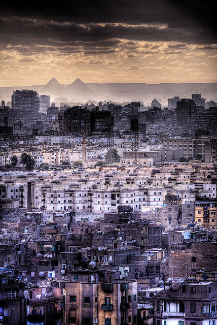 """The Ancient and the Modern"" Cairo cityscape with the Giza pyramids visible in the background Photo by Graspnext"