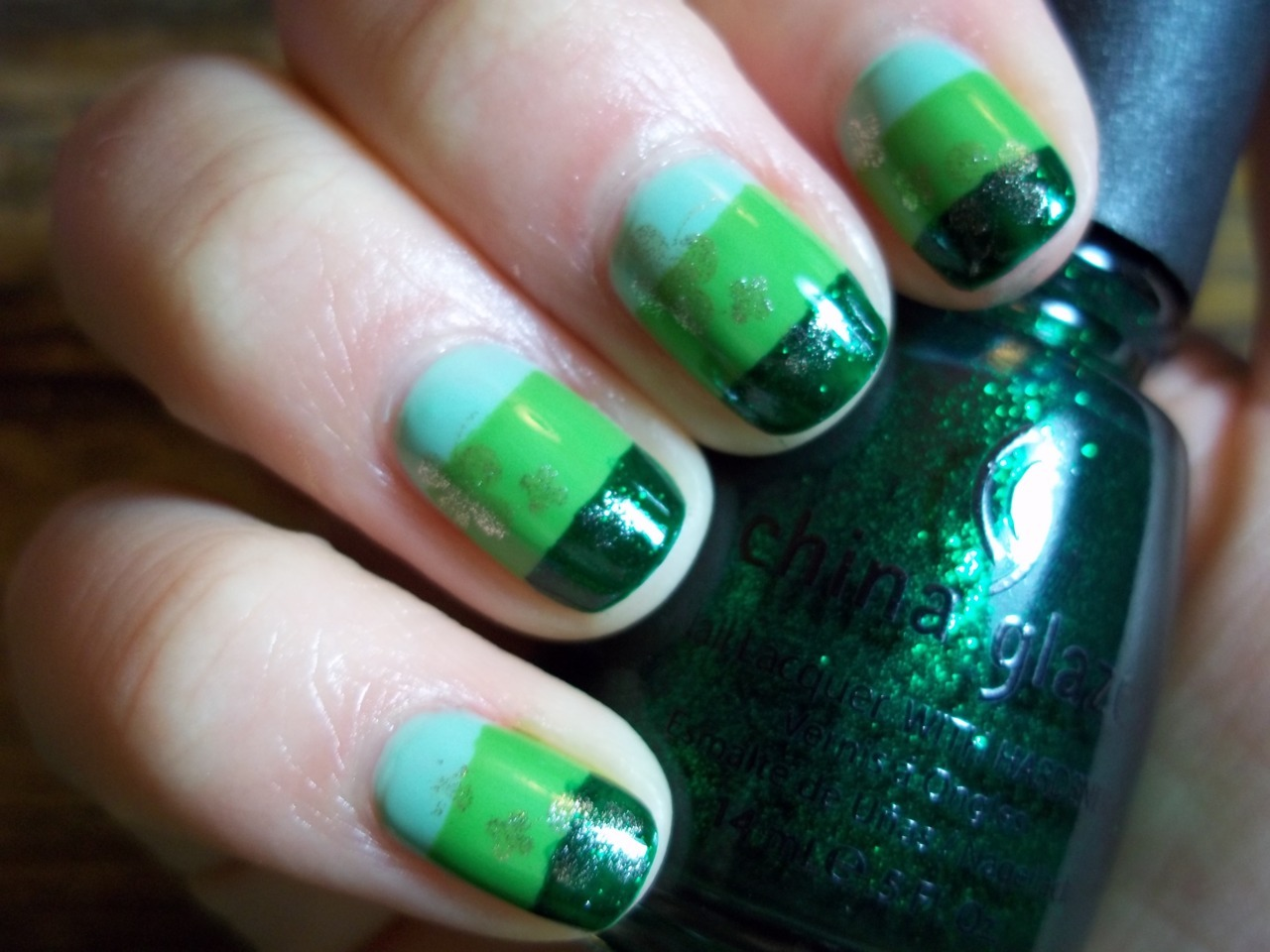 My St. Patrick's day manicure. I used OPI Hey, Get In Lime!, OPI Greenwich Village, and China Glaze Emerald Sparkle (in that order). Orly Luxe was used for the shamrocks. I'm hoping that it chips before the 17th so I can use the excuse for another green manicure (as if I need one…).