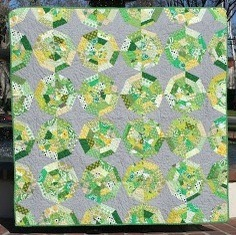 So pretty. Green Spiderweb Quilt by Tamiko, featured on her blog. She used this tutorial.