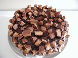 peanut butter & chocolate cake with pb & chocolate ganache 1 box (18.25 ounces) devil's food cake mix 3 eggs 1 cup buttermilk 1/2 cup vegetable oil Good pinch of salt 2 cups mini Reese peanut butter cups, chopped, plus 1 1/2 cups more for garnish (about 2 - 12oz. bags) Ganache 12 ounces dark chocolate, chopped 1 cup heavy cream 3/4 cup creamy peanut butter 4 TB of confectioners sugar