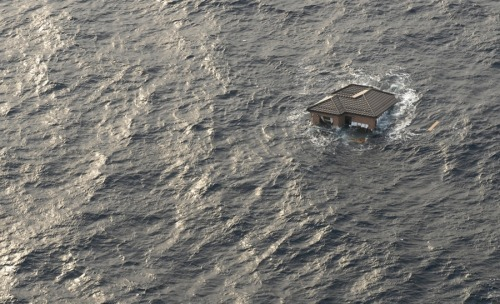 A house floats in the Pacific Ocean off the Japanese coast