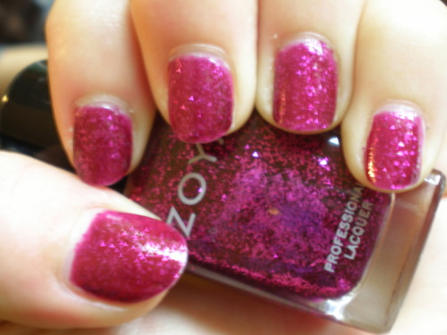 Roxy by Zoya At this point, half of our previous 10 posts have featured Zoya polishes. I wish Zoya were somehow compensating us for our reviews, but the truth is that their frequent promos make it too easy to acquire their polishes, and Zoya is steadily occupying a greater and greater proportion of our collections. When you see beauties like Roxy, it's not hard to understand why. The magnificence of this magenta glitter polish has to be witnessed in person. It's so glittery that it gave my camera trouble with  focusing, hence this blurry picture. This is two coats, but perhaps three would have been better since the glitter is not packed too densely into the jelly base. If I had to name the perfect color to wear to a club, this would be it. Just be warned: it dries semi-matte, so top coat is absolutely necessary.
