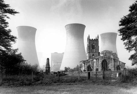 "nickkahler:  Eric de Mare, Ferrybridge Power Stations, Knottingly, England, c. 1927 (via BLDGBLOG) ""The above photo has really stuck with me since seeing it last week over at Millennium People—not only its juxtaposition of architectural types (the narrative ornamentalism of a small English church almost literally overshadowed by the minimalist hyper-functionalism of the cooling towers) but the photo's implied collision of material activities (prayer, say, vs. the illuminative processing of rare fuels). I might even suggest that it presents us with some strange, nuclear-Anglican revision of what Manfredo Tafuri would call the sphere and the labyrinth—that is, the altarpiece meets the reactor core—but the station is actually coal-powered, not nuclear at all. The image is nonetheless quite stimulating. Imagine disused cooling towers repurposed as a church—or a library—or Chartres Cathedral put to work as a nuclear power station, its filigrees of saints and masonry trembling as atoms split and machines spin wildly in the basement."""