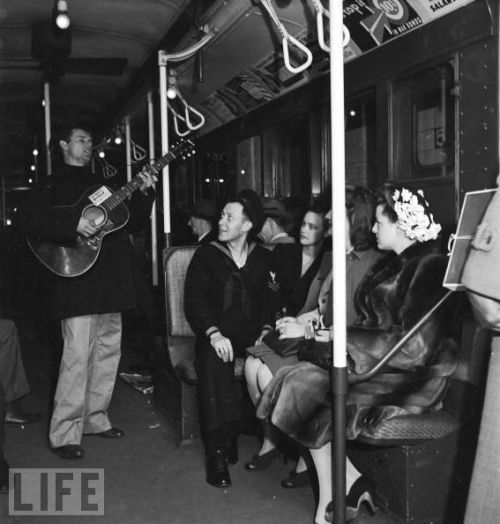Woody Guthrie plays for subway riders at the 59th Street station in 1943, back when the MTA knew how to book top talent, via Life.
