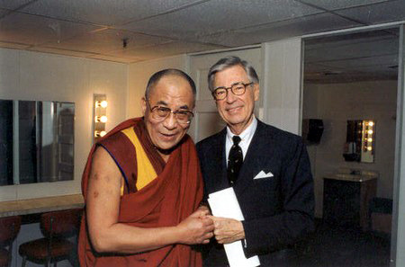 "retrogasm:  Mister Rogers and the Dalai Lama  1. Even Koko the Gorilla Loved Him Most people have heard of Koko, the Stanford-educated gorilla who could speak about 1000 words in American Sign Language, and understand about 2000 in English. What most people don't know, however, is that Koko was an avid Mister Rogers' Neighborhood fan. As Esquire reported, when Fred Rogers took a trip out to meet Koko for his show, not only did she immediately wrap her arms around him and embrace him, she did what she'd always seen him do onscreen: she proceeded to take his shoes off! 2. He Made Thieves Think Twice According to a TV Guide profile, Fred Rogers drove a plain old Impala for years. One day, however, the car was stolen from the street near the TV station. When Rogers filed a police report, the story was picked up by every newspaper, radio and media outlet around town. Amazingly, within 48 hours the car was left in the exact spot where it was taken from, with an apology on the dashboard. It read, ""If we'd known it was yours, we never would have taken it."" 3. He Watched His Figure to the Pound In covering Rogers' daily routine (waking up at 5; praying for a few hours for all of his friends and family; studying; writing, making calls and reaching out to every fan who took the time to write him; going for a morning swim; getting on a scale; then really starting his day), writer Tom Junod explained that Mr. Rogers weighed in at exactly 143 pounds every day for the last 30 years of his life. He didn't smoke, didn't drink, didn't eat the flesh of any animals, and was extremely disciplined in his daily routine. And while I'm not sure if any of that was because he'd mostly grown up a chubby, single child, Junod points out that Rogers found beauty in the number 143. According to the piece, Rogers came ""to see that number as a gift… because, as he says, ""the number 143 means 'I love you.' It takes one letter to say 'I' and four letters to say 'love' and three letters to say 'you.' One hundred and forty-three."" 4. He Saved Both Public Television and the VCR Strange but true. When the government wanted to cut Public Television funds in 1969, the relatively unknown Mister Rogers went to Washington. Almost straight out of a Capra film, his testimony on how TV had the potential to give kids hope and create more productive citizens was so simple but passionate that even the most gruff politicians were charmed. While the budget should have been cut, the funding instead jumped from $9 to $22 million. Rogers also swayed the Supreme Court to allow VCRs to record television shows from the home. It was a cantankerous debate at the time, but his argument was that recording a program like his allowed working parents to sit down with their children and watch shows as a family. 5. He Might Have Been the Most Tolerant American Ever Mister Rogers seems to have been almost exactly the same off-screen as he was onscreen. As an ordained Presbyterian minister, and a man of tremendous faith, Mister Rogers preached tolerance first. Whenever he was asked to castigate non-Christians or gays for their differing beliefs, he would instead face them and say, with sincerity, ""God loves you just the way you are."" Often this provoked ire from fundamentalists. 6. He Was Genuinely Curious About Others Mister Rogers was known as one of the toughest interviews because he'd often befriend reporters, asking them tons of questions, taking pictures of them, compiling an album for them at the end of their time together, and calling them after to check in on them and hear about their families. He wasn't concerned with himself, and genuinely loved hearing the life stories of others. Amazingly, it wasn't just with reporters. Once, on a fancy trip up to a PBS exec's house, he heard the limo driver was going to wait outside for 2 hours, so he insisted the driver come in and join them (which flustered the host). On the way back, Rogers sat up front, and when he learned that they were passing the driver's home on the way, he asked if they could stop in to meet his family. According to the driver, it was one of the best nights of his life—the house supposedly lit up when Rogers arrived, and he played jazz piano and bantered with them late into the night. Further, like with the reporters, Rogers sent him notes and kept in touch with the driver for the rest of his life. 7. He Was Color-blind Literally. He couldn't see the color blue. Of course, he was also figuratively color-blind, as you probably guessed. As were his parents who took in a black foster child when Rogers was growing up. 8. He Could Make a Subway Car full of Strangers Sing Once while rushing to a New York meeting, there were no cabs available, so Rogers and one of his colleagues hopped on the subway. Esquire reported that the car was filled with people, and they assumed they wouldn't be noticed. But when the crowd spotted Rogers, they all simultaneously burst into song, chanting ""It's a beautiful day in the neighborhood."" The result made Rogers smile wide. A few more things about him… 9. He Got into TV Because He Hated TV. The first time he turned one on, he saw people angrily throwing pies in each other's faces. He immediately vowed to use the medium for better than that. Over the years he covered topics as varied as why kids shouldn't be scared of a haircut, or the bathroom drain (because you won't fit!), to divorce and war. 10. He Was an Ivy League Dropout. Rogers moved from Dartmouth to Rollins College to pursue his studies in music. 11. He Composed all the Songs on the Show, and over 200 tunes. 12. He Was a perfectionist, and Disliked Ad Libbing. He felt he owed it to children to make sure every word on his show was thought out. 13. Michael Keaton Got His Start on the Show as an assistant — helping puppeteer and operate the trolley. 14. Several Characters on the Show are Named for His Family. Queen Sara is named after Rogers' wife, and the postman Mr. McFeely is named for his maternal grandfather who always talked to him like an adult, and reminded young Fred that he made every day special just by being himself. Sound familiar? It was the same way Mister Rogers closed every show.15. The Sweaters. Every one of the cardigans he wore on the show had been hand-knit by his mother. Source: http://www.mentalfloss.com/blogs/archives/5943  without a doubt, Mister Rogers is one of my favorite humans and reading these kinds of wonderful things about him makes me cry - but in a good way - in an overflowing love kind of way."