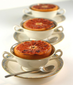 Grapefruit Brulee Ingredients 2 large pink or ruby-red grapefruits 4 tablespoons packed dark brown sugar 2 teaspoon butter, cut into tiny pieces 1/4 teaspoon ground cinnamon 1/4 teaspoon freshly grated nutmeg Directions  Position oven rack about 5 inches from broiler; preheat broiler.   Slice the stem end and opposite end off each grapefruit to stabilize. Use a paring knife to separate the sections from the rind, but leave in shell (or don't — it's up to you).   Place the halves in a large baking pan. Top  each with some brown sugar, dot with butter and sprinkle with  a pinch of cinnamon and nutmeg.   Broil the grapefruit until bubbling and starting to brown, 6 to 8 minutes. Drizzle pan juices over each serving.  Alternatively, try this recipe. 4 servings (1/2 grapefruit), 121 Calories each. (Or 242 for a whole grapefruit.)