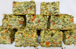 Vegetable Kugel Ingredients:  10  ounces  frozen spinach, thawed and drained   2    onions, chopped  1  stalk  celery, chopped  1    red pepper, chopped  3    carrots, grated  1  cup  mushroom, chopped  1  tablespoon  olive oil  2    eggs     + 2    egg whites  1/4 teaspoon  salt  1/4 teaspoon  pepper  1/2 teaspoon  garlic powder  1/2 teaspoon  dried basil  1/4 cup  matzo meal   Preheat oven to 350 degrees F.  Heat a non-stick pan with medium heat. Lightly spritz with cooking spray and sauté onion, celery, red pepper  and carrots for 5 minutes, until golden.  Add mushrooms and cook 5 minutes longer.  Mix in all the remaining ingredients and pour  shallow roasting or  lasagna pan prepared with cooking spray.  Bake  uncovered for 45 to 50  minutes until the kugel is firm set.  Cut into squares and serve.  Four servings, 183 Calories each.
