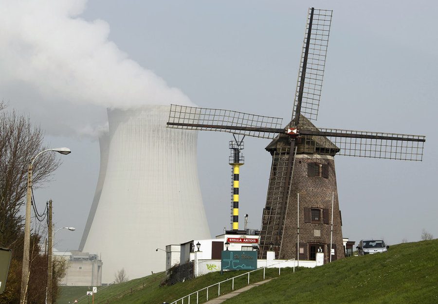 Here's a juxtaposition of old and new ways to harness energy A windmill is seen near the Doel nuclear plant in northern Belgium March 15, 2011. European governments are stepping up efforts to assess nuclear safety in their own countries as Japan scrambles to prevent a nuclear catastrophe after Friday's earthquake. -  PhotoBlog