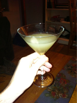 Golden Martini @home  1.5 oz Gin 1 oz Triple Sec .5 oz Citrus Vodka .25 oz Brandy 6 small thin ginger root slices Shake all and serve up.