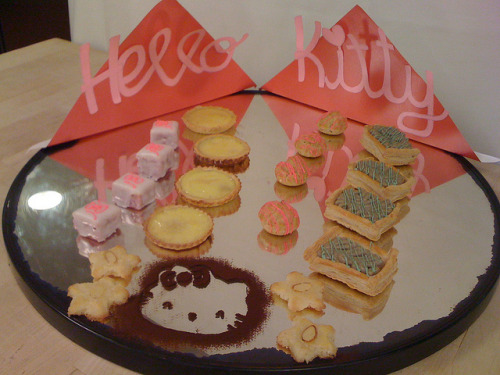 Hello Kitty Mirror Buffet  Sweet taro petit four secs, egg custard tart, green tea profiteroles,  puff pastry with sweet red bean paste and green tea pastry cream, and  almond cookies