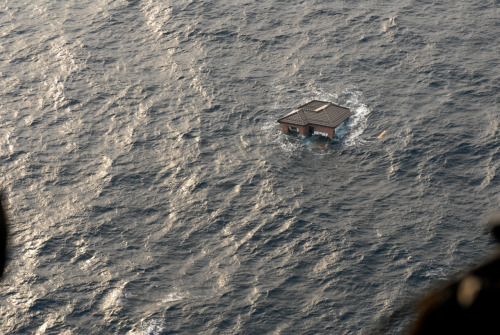 The navy spotted this Japanese home floating away in the ocean. via www.navy.mil