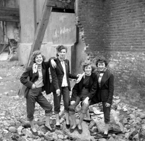 "Teddy Girls by Ken Russell Elsie Hendon, 15, Jean Rayner, 14, Rosie Hendon, 15, and Mary Toovey on a bombsite in Southam Street, North Kensington, West London.  Teddy Girls, a little-known aspect of the more well-known ""Teddy Boy"" movement, were working class Londoners, some of them Irish immigrants, who dressed in neo-Edwardian fashions. Today they are little known and little documented; save a lovely photoshoot by Ken Russell, they might have been forgotten entirely. The movement emerged in the late 1940s, as part of the emerging ""youth culture"" that rose from post-war Britain and America."