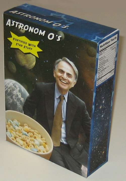 "Umm… Awesome! Check out the link (here) and someone write to General Mills! (And perhaps cut down a bit on the sugar content - it's filled with stars and moons from Lucky Charms. I think Carl would be in favor.) Any good tagline ideas, anyone? (Though I do love the ""Fortified with Star-Stuff""!)"