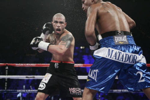 Miguel Cotto wins by TKO Just as his trainer Emanuel Steward predicted, Miguel Cotto dropped loudmouth Ricardo Mayorga to the canvas to end an incredible fight vía 12th round TKO.